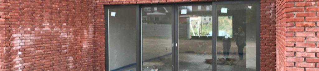 Ramen, deuren en garagepoorten op maat bij Wauters Renovatiewerken